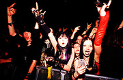 "Nu Metal ""Cradle Of Filth"" fans do devil horn hand signal, UK, 2000s."