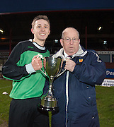 Dundee captain Keir Reilly is presented with the cup by Scottish Schools FA president Rod Houston - Dundee v Forth Valley, Scottish Schools FA Senior Cup Final at Dens Park..© David Young - 5 Foundry Place - Monifieth - DD5 4BB - Telephone 07765 252616 - email: davidyoungphoto@gmail.com - web: www.davidyoungphoto.co.uk