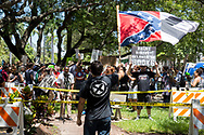 Christopher Rey Monzon, 22,  waves a confederate flag toward a group of people protesting in front of Hollywood's City Hall demanding the removal of streets signs  named after confederate generals and a KKK wizard on Wednesday August 30, 2017<br /> <br /> photo by Samuel Navarro.