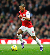 Picture by Andrew Tobin/Focus Images Ltd. 07710 761829. .21/01/12. Theo Walcott (14) of Arsenal on the ball during the Barclays Premier League match between Arsenal and Manchester United at Emirates Stadium, London.
