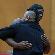 Newark Nazr Roberson celebrates with his coach after defeating William Penn Dom Trotta in a 220 pound bout during the Blue Hen Conference Wrestling Tournament Finals Saturday, Feb. 20, 2016 at William Penn High School in New Castle.