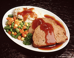 FOOD Blue plate dinner special meat loaf mashed potatos gravy mixed vegetables corn peas green beans carrots garnish parsley