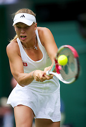 27.06.2012, Wimbledon, London, GBR, WTA, The Championships Wimbledon, im Bild Caroline Wozniacki (DEN) during the Ladies' Singles 1st Round match on day three of the WTA Tour Wimbledon Lawn Tennis Championships at the All England Lawn Tennis and Croquet Club, London, Great Britain on 2012/06/27. EXPA Pictures © 2012, PhotoCredit: EXPA/ Propagandaphoto/ David Rawcliff..***** ATTENTION - OUT OF ENG, GBR, UK *****