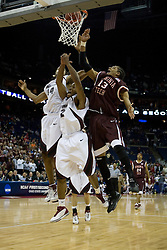 Virginia Tech Hokies forward Deron Washington (13) battles Southern Illinois Salukis guard C.J. Smith (2) and Southern Illinois Salukis forward Randal Falker (14) for a rebound.  The #4 seed Southern Illinois Salukis defeated the #5 seed Virginia Tech Hokies 63-48 in the second round of the Men's NCAA Basketball Tournament at the Nationwide Arena in Columbus, OH on March 18, 2007.