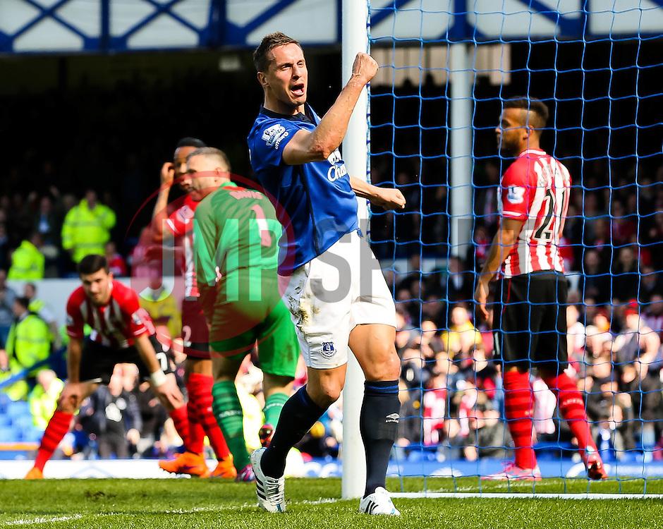 Everton's Phil Jagielka celebrates after scoring the opening goal  - Photo mandatory by-line: Matt McNulty/JMP - Mobile: 07966 386802 - 04/04/2015 - SPORT - Football - Liverpool - Goodison Park - Everton v Southampton - Barclays Premier League