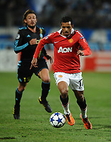 Football - Champions League Round of 16 First Leg - Marseille vs. Manchester United<br /> Nani of Manchester United is chased by Gabriel Heinze of Marseille at the Stade Velodrome, Marseille