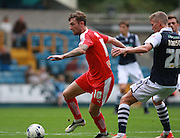 Chesterfield player Jay O'Shea gets the better of Millwall player Steve Morison during the Sky Bet League 1 match between Millwall and Chesterfield at The Den, London, England on 29 August 2015. Photo by Bennett Dean.