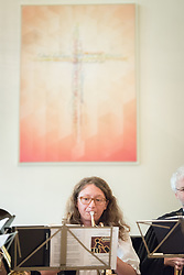 "1 July 2018, Geneva, Switzerland: Annegret Kapp plays the trumpet. On Sunday, LWF Council members joined local congregants for Sunday service at the Evangelical Lutheran Church in Geneva. The 2018 LWF Council meeting takes place in Geneva from 27 June - 2 July. The theme of the Council  is ""Freely you have received, freely give"" (Matthew 10:8, NIV). The LWF Council meets yearly and is the highest authority of the LWF between assemblies. It consists of the President, the Chairperson of the Finance Committee, and 48 members from LWF member churches in seven regions."