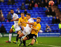 Tranmere Rovers's Josh Thompson clears from Bristol Rovers' Matty Taylor - Photo mandatory by-line: Neil Brookman/JMP - Mobile: 07966 386802 - 08/11/2014 - SPORT - Football - Birkenhead - Prenton Park - Tranmere Rovers v Bristol Rovers - FA Cup - Round One