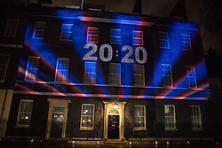 London, UK. 31 January, 2020. Numbers spelling the year 2020 appear on a Brexit countdown clock projected against a background of red, white and blue lighting onto 10 Downing Street to count down to the moment when the UK leaves the European Union.
