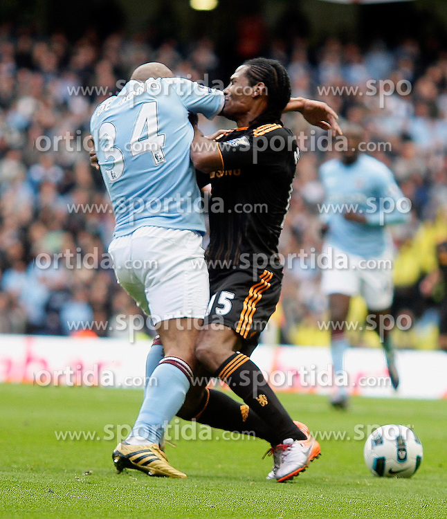 25.09.2010, City of Manchester Stadium, Manchester, ENG, PL, Manchester City vs Chelsea FC, im Bild Manchester City's Nigel de Jong elbows Florent Malouda of Chelsea, EXPA Pictures © 2010, PhotoCredit: EXPA/ IPS/ M. Atkins *** ATTENTION *** UK AND FRANCE OUT! / SPORTIDA PHOTO AGENCY