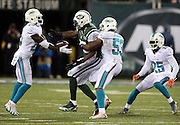 Miami Dolphins outside linebacker Jelani Jenkins (53) breaks up a late fourth quarter pass intended for New York Jets tight end Jeff Cumberland (85) that gets intercepted by Miami Dolphins strong safety Reshad Jones (20) and clinching the win during the NFL week 13 regular season football game against the New York Jets on Monday, Dec. 1, 2014 in East Rutherford, N.J. The Dolphins won the game 16-13. ©Paul Anthony Spinelli
