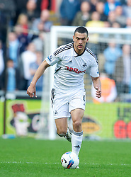 SWANSEA, WALES - Sunday, March 11, 2012: Swansea City's Steven Caulker in action against Manchester City during the Premiership match at the Liberty Stadium. (Pic by David Rawcliffe/Propaganda)
