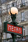 Metro sign in front of typical Paris architecture, Boulevard Saint Germain, Paris, France