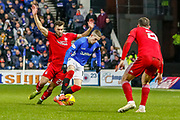 Dominic Ball of Aberdeen FC tries to get the ball from Ryan Kent during the William Hill Scottish Cup quarter final replay match between Rangers and Aberdeen at Ibrox, Glasgow, Scotland on 12 March 2019.