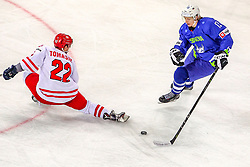 Damian Tomasik of Poland vs Jan Drozg of Slovenia during Ice Hockey match between National Teams of Slovenia and Poland in Round #2 of 2018 IIHF Ice Hockey World Championship Division I Group A, on April 23, 2018 in Budapest, Hungary. Photo by David Balogh / Sportida