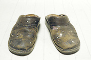pair of old slippers with paint spots