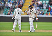 50 for Mark Stoneman of Surrey - Mark Stoneman of Surrey celebrates scoring a half century and is congratulated by Rory Burns of Surrey during the opening day of the Specsavers County Champ Div 1 match between Somerset County Cricket Club and Surrey County Cricket Club at the Cooper Associates County Ground, Taunton, United Kingdom on 18 September 2018.
