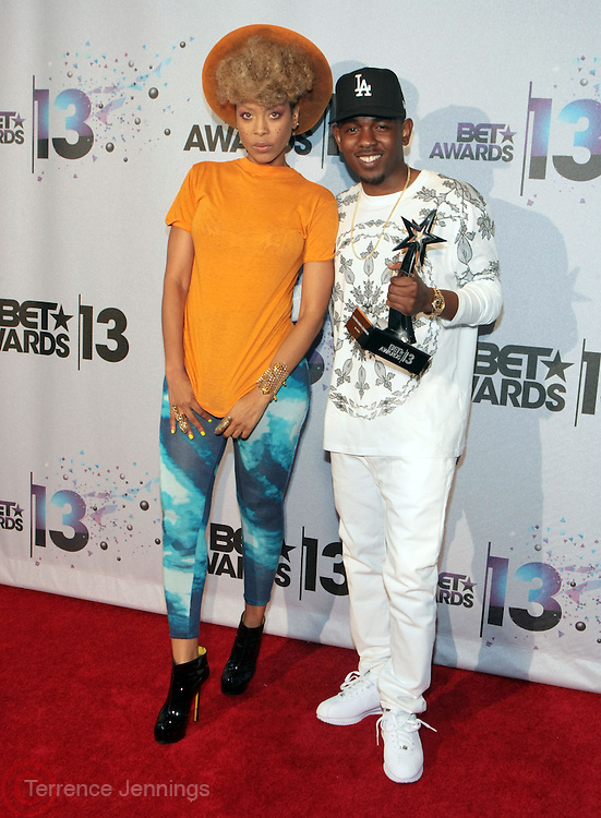 Los Angeles, CA-June 30:  (L-R) Recording Artists Erykah Badu and Kendrick Lamar backstage at the 2013 BET Awards Winners's Room Inside held at LA Live on June 30, 2013 in Los Angeles, CA. ©Terrence Jennings