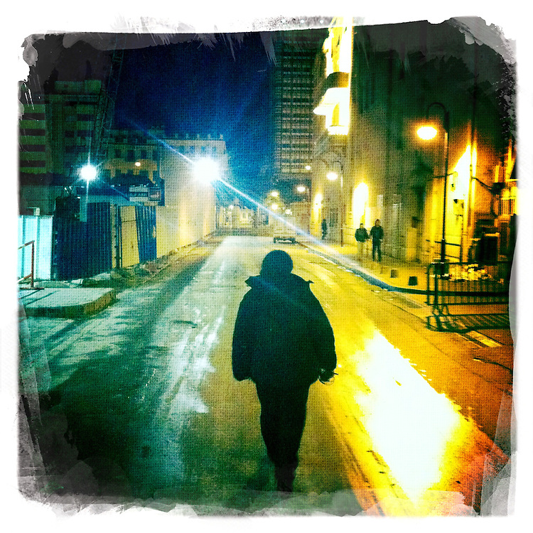 """.A man is seen walking alone towards avenue Habib Bourguiba in the centre of Tunis on february 3, 2011./// Copyright Benjamin Girette. On january the 14th 2011, Zine el-Abidine Ben Ali President of Tunisia and his famous wife Leila Trabelsi as know as """"The regent of Carthage"""" are forced to escape the country after 24 years of power..The revolution is not done yet, Ben Ali is gone nevertheless a democratic President still needs to emerge. A new democraty is in design for the next six months, it might be the birth of the first democraty in the arab world..."""
