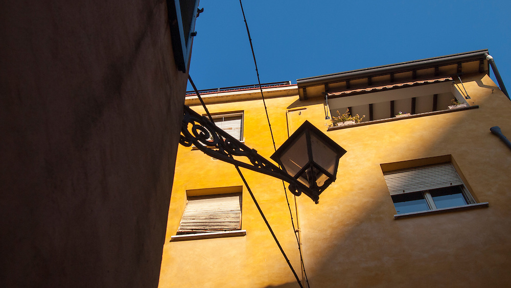 Streetscapes :Apartment, Mantua, Italy. A series of captures from a personal trip to the cities of Milan and Mantua, featuring explorations of Renaissance architecture and the vibrant life of Italian streets.
