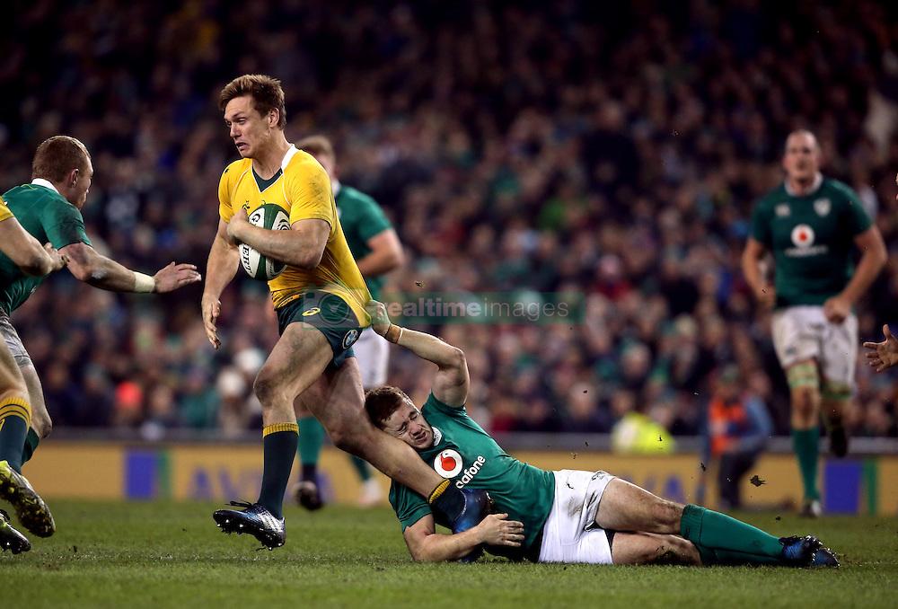 Ireland's Paddy Jackson tackles Australia's Dane Haylett-Petty during the Autumn International match at the Aviva Stadium, Dublin.