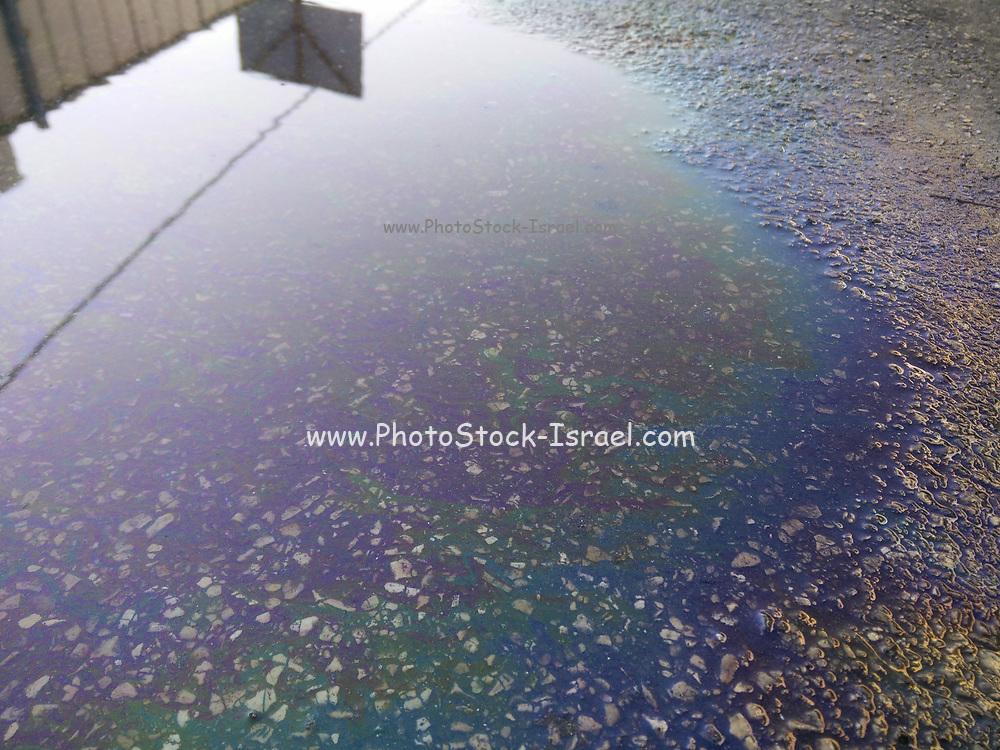 Oil Spill rainbow colors on tarmac