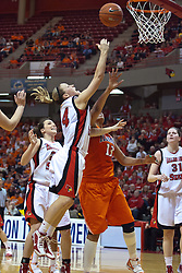 28 March 2010: Amanda Clifton drives in for a lay up that Jenna Smith can't defend. The Redbirds of Illinois State squeak past the Illini of Illinois 53-51 in the 4th round of the 2010 Women's National Invitational Tournament (WNIT) on Doug Collins Court inside Redbird Arena at Normal Illinois.
