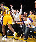Ron Artest gives a little love to the courtside fans after making a 3 pointer in the first half. The Lakers defeated the Boston Celtics in game 7 of the NBA Finals  83-79 in Los Angeles, CA 06/16/2010 (John McCoy/Staff Photographer).