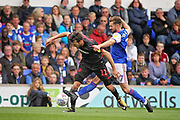 Ipswich Town midfielder Gwion Edwards (7)  tackles Bolton Wanderers midfielder William Buckley (11) during the EFL Sky Bet Championship match between Ipswich Town and Bolton Wanderers at Portman Road, Ipswich, England on 22 September 2018.