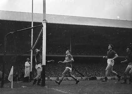 All Ireland Senior Football Championship Final, Kerry v Down, 25.09.1960, 09.25.1960, 25th September 1960, Down 2-10 Kerry 0-8, ..John Dowling Kerry full foward watches as his ball sails over the bar for a point, also in picture are Down goalie E McKay and Full back L Murphy, ..Referee J Dowling (Offaly),.Captain K Mussen,.