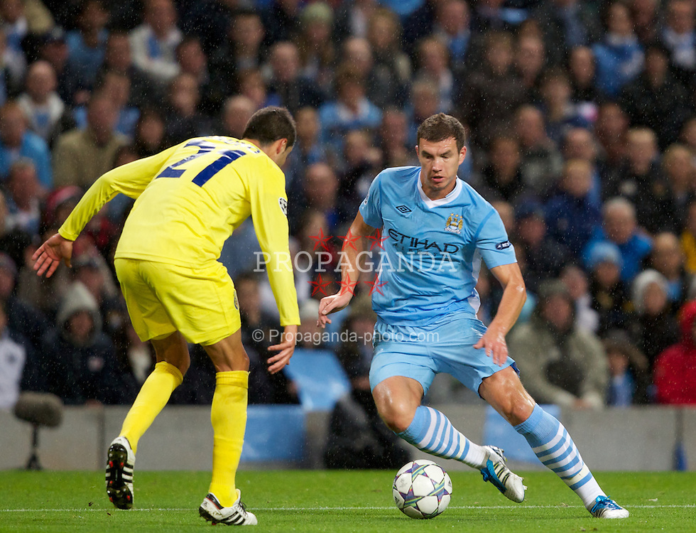 MANCHESTER, ENGLAND - Tuesday, Octover 18, 2011: Manchester City's Edin Dzeko in action against Villarreal CF during the UEFA Champions League Group A match at the City of Manchester Stadium. (Pic by Vegard Grott/Propaganda)