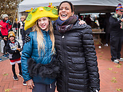 28 NOVEMBER 2019 - DES MOINES, IOWA: US Senator KAMALA HARRIS (D-CA) talks to a girl wearing a taco hat in the finish area of the Turkey Trot. The Turkey Trot is an annual Des Moines Thanksgiving Day 5 mile fun run. Sen. Harris greeted runners in the finish area and handed out cookies. She is running to be the Democratic nominee for the US Presidency in 2020. Iowa hosts the first selection event of the presidential election season. The Iowa caucuses are February 3, 2020.              PHOTO BY JACK KURTZ