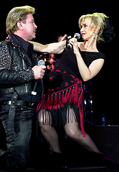 Pop Duo, Dollar on tour with<br /><br />Steve Starnge (Visage)<br />Claire Grogan (Altered Images)<br />The Belle Stars<br />Kim Wilde<br />The Human League<br />Play on the Here and Now  Christmas Party Tour at Sheffields Hallam FM Arena Friday 13th December 2002<br /><br />[#Beginning of Shooting Data Section]<br />Nikon D1 <br />2002/12/13 21:27:21.0<br />JPEG (8-bit) Fine<br />Image Size:  2000 x 1312<br />Color<br />Lens: 50mm f/1.8<br />Focal Length: 50mm<br />Exposure Mode: Manual<br />Metering Mode: Spot<br />1/200 sec - f/3.2<br />Exposure Comp.: 0 EV<br />Sensitivity: ISO 800<br />White Balance: Auto<br />AF Mode: AF-S<br />Tone Comp: Normal<br />Flash Sync Mode: Not Attached<br />Color Mode: <br />Hue Adjustment: <br />Sharpening: Normal<br />Noise Reduction: <br />Image Comment: <br />[#End of Shooting Data Section]