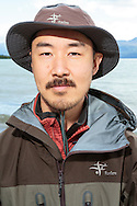 Wildlife photographer Takeshi Hanatani by the Skilak Lake, Alaska, USA.