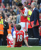Football - 2016 / 2017 Premier League - Arsenal vs. Everton<br /> <br /> A dejected Francis Coquelin and Nacho Monreal of Arsenal after failing to qualify for the Champions League after the match at The Emirates.<br /> <br /> COLORSPORT/ANDREW COWIE