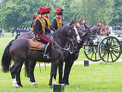 Hyde Park, London, June 2nd 2016. Soldiers and guns of the King's Troop Royal Horse Artillery fire a 41 round Royal Salute to mark the 63rd anniversary of the coronation of Britain's Monarch HM Queen Elizabeth II. PICTURED: Troops leave the field following the salute.