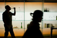 9 July, 2008. New York, NY. Andrew Bradbury (40), creator and founder of the CLO wine bar, tastes a glass of red wine in front of his shop at the Time Warner Center, where bottles, carafes and wine glasses are displayed. CLO is a wine bar that will open next week at the 4th floor lobby of the Time Warner Center. The large variety of wines can be viewed on the interactive wine database projected on the bar.<br /> <br /> ©2008 Gianni Cipriano for The New York Times<br /> cell. +1 646 465 2168 (USA)<br /> cell. +1 328 567 7923 (Italy)<br /> gianni@giannicipriano.com<br /> www.giannicipriano.com