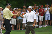 Jun 26, 2006; Gaylord MI; USA;  2005 Shootout champion Andy North Congradulates Fred Couples after Couples birdies the final hole for a skin and the win at the 2006 ING Par-3 Shootout at Treetops Resort in Gaylord Michigan.