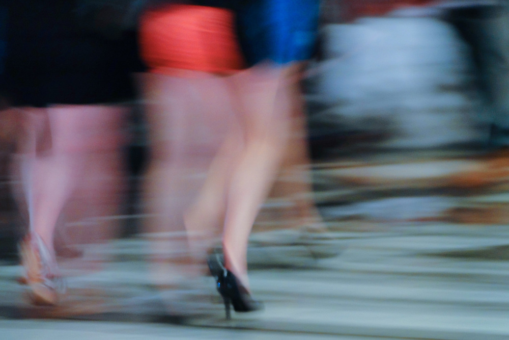 Motion shot of Women wearing high heels on the street. NYC 2010