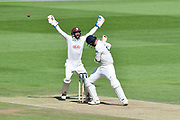 Wicket - Kyle Abbott of Hampshire is trapped LBW by Amar Virdi of Surrey as Ben Foakes of Surrey celebrates during the Specsavers County Champ Div 1 match between Hampshire County Cricket Club and Surrey County Cricket Club at the Ageas Bowl, Southampton, United Kingdom on 11 June 2018. Picture by Graham Hunt.