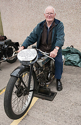"© Licensed to London News Pictures. 24/05/2015. Warmley, South Gloucestershire UK.  Picture of Henry Body on his Douglas Motorcycles at the annual rally of vintage Douglas Motorcycles at Kingswood Heritage Museum.  Henry Body is 80 years old and his bike is 86 years old.  Henry says he has raced in 276 events and won 271 times. The world famous Douglas bikes were built in Kingswood from 1907 to 1957. Some 25000 were constructed for military use in the First World War. The bikes were regular winners of the Isle of Man TT races. Bill Douglas, great grandson of the founders of the firm, said: ""It is always a stirring sight to see the bikes in action, and we expect a big turnout around the area to watch the cavalcade"". Photo credit : Simon Chapman/LNP"