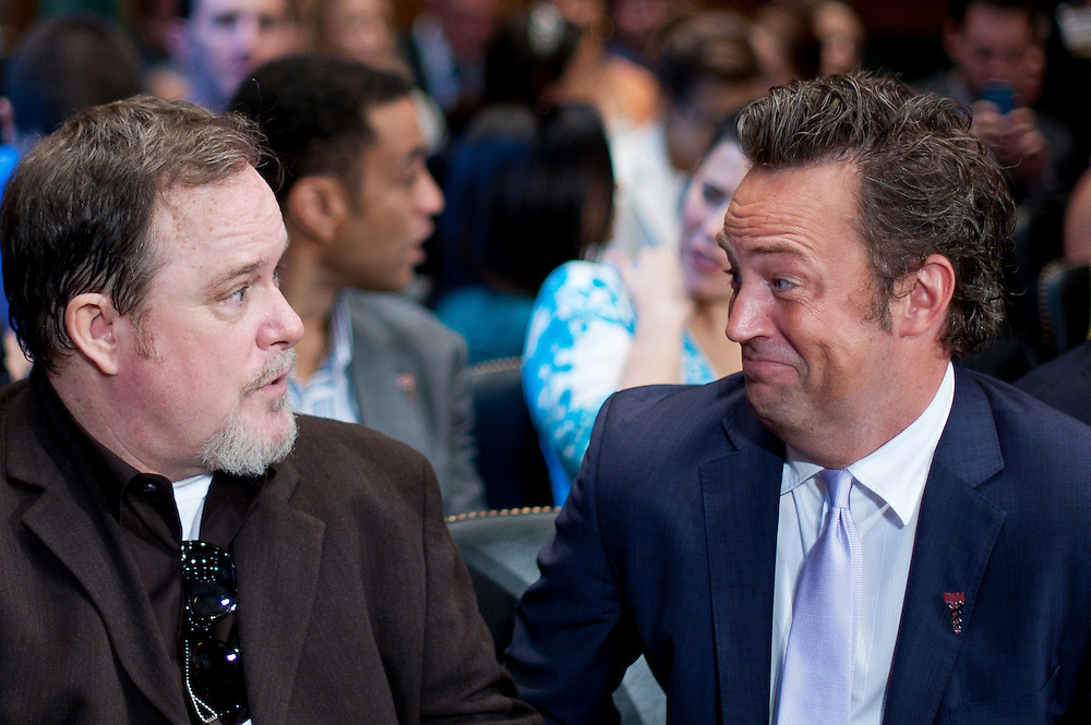 """Addiction intervention specialist EARL HIGHTOWER and actor MATTHEW PERRY talk before the start of a Senate Judiciary Committee hearing """"Drug and Veterans Treatment Courts: Seeking Cost-Effective Solutions for Protecting Public Safety and Reducing Recidivism."""""""