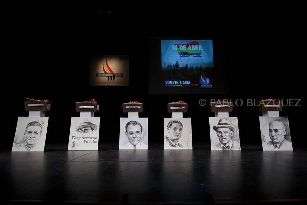 14/04/2018. Coffins containing remains of victims of Spain's Civil War and portraits depicting Victoriano Tarancon (L), Eloy Serrano Forcen (2L), Hipolito Olmo Fernandez (3L), Elicio Gomez (3R),  Francisco Romero Carrasco (2R) and Abundio Andaluz (R) exhumed in Cobertelada and Calata&ntilde;azor are displayed on stage at the Centro Cultural Palacio de la Audiencia during a homage to hand the remains to their relatives on April 14, 2018 in Soria, Spain. La Asociacion Soriana Recuerdo y Dignidad (ASRD) 'The Soria Association for Memory and Dignity' celebrated a tribute to hand over the remains of civil war victims to their families. The Society of Sciences of ARANZADI helped with the research, exhumation and identification of the bodies, after villagers passed the information about the mass grave, 81 years after the assassination took place, to the ASRD. Seven people were assassinated around August 25, 1936 by Falangists, as part of General Francisco Franco armed forces, and buried in the 'Fosa de los Maestros' (Teachers Mass Grave) near Cobertelada, Soria, after being taken from prison of Almazan during the Spanish Civil War. Five of them were teachers in the region, and also friends of Spanish writer Antonio Machado. The other two still remain unidentified. Another body was assassinated by Falangists accompanied by a priest in 1936, and was exhumed on 23 September of 2017 near Calata&ntilde;azor, Soria. It belonged to Abundio Andaluz, a politician, lawyer and musician in Soria.<br /> Spain's Civil War took the lives of thousands of people on both sides, and civilians. But Franco continued his executions after the war has finished. Teachers, as part of the education sector, were often a target of Franco's forces. Spanish governments has never done anything to help the victims of the Civil War and Franco's dictatorship while there are still thousands of people missing in mass graves around the country. (&copy; Pablo Blazquez)