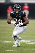 Jacksonville Jaguars running back Carlos Hyde (34) runs with the ball after catching a fourth quarter pass during the NFL week 13 regular season football game against the Indianapolis Colts on Sunday, Dec. 2, 2018 in Jacksonville, Fla. The Jaguars won the game in a 6-0 shutout. (©Paul Anthony Spinelli)
