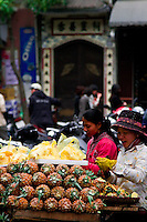 Delicious freshly peeled pineapples are available from many of the street vendors in the old quarter of Hanoi.