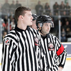 TRENTON, - Apr 17, 2016 -  Ontario Junior Hockey League game action between the Trenton Golden Hawks and the Georgetown Raiders. Game 3 of the Buckland Cup Championship Series, OHA Linesman and OHA Referee at the Duncan Memorial Gardens, ON. (Photo by Amy Deroche / OJHL Images)