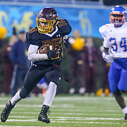 Milford TYREKE BENSON (13) gains extra yardage after the catch during the 2017 DIAA Division II state championship game between the Delmar and Milford Saturday, Dec. 02, 2017 at Delaware Stadium in Newark, DE.