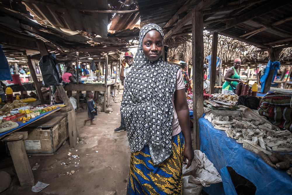 A woman poses in the market in Ganta, Liberia