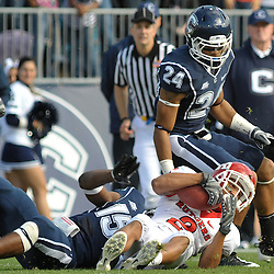 Oct 31, 2009; East Hartford, CT, USA; Rutgers wide receiver Tim Brown (2) holds on to a reception after being tackled by Connecticut safety Jerome Junior (15) during first half Big East NCAA football action between Rutgers and Connecticut at Rentschler Field.